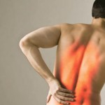 a shirtless man with superimposed graphic showing back pain