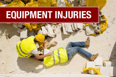 a man in construction wear assisting an injured construction worker who is lying on the ground after an accident