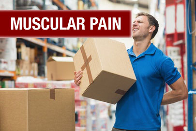 man in warehouse holding a box in one hand and rubbing his back with the other as he grimaces in pain