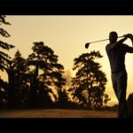 man at sunset playing golf