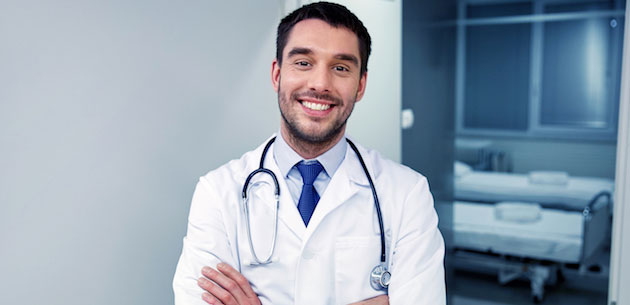 doctor in lab coat with stethoscope, smiling