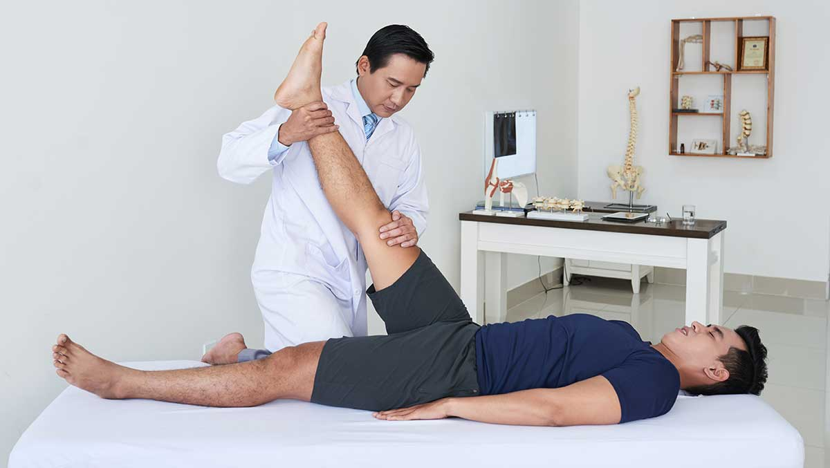 Chiropractor stretching a patient's leg