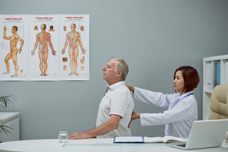 Chiropractor checking spine