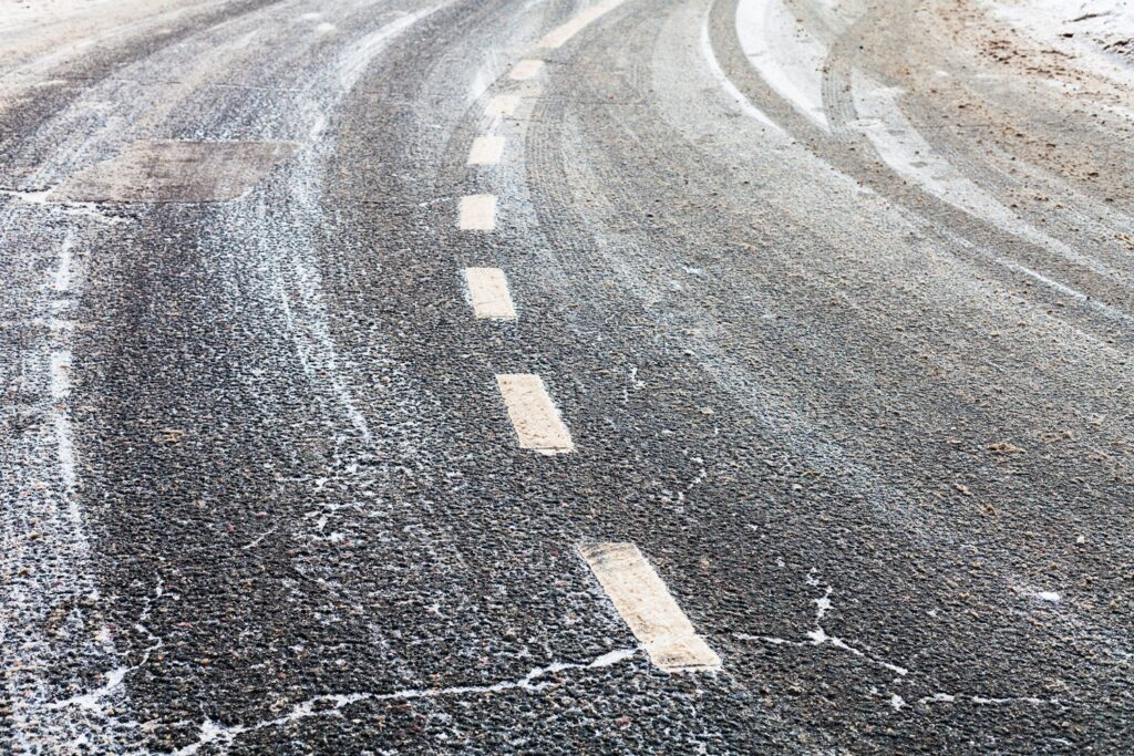 center dotted lines on a snowy road